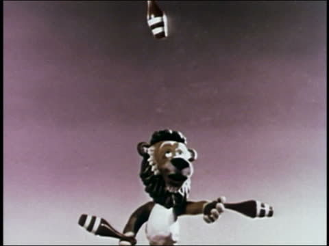 1947 ANIMATION lion juggling bottles in air / AUDIO