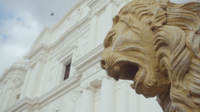 Lion statue close up at Leon Nicaragua cathedral. Profile. Scary expression.