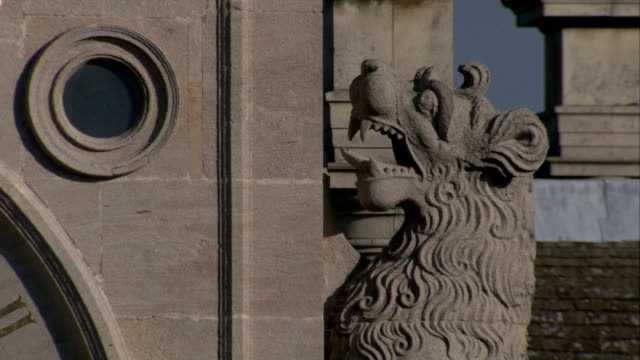 a lion statue decorates the exterior of burghley house in northamptonshire, england. available in hd. - stately home stock videos and b-roll footage