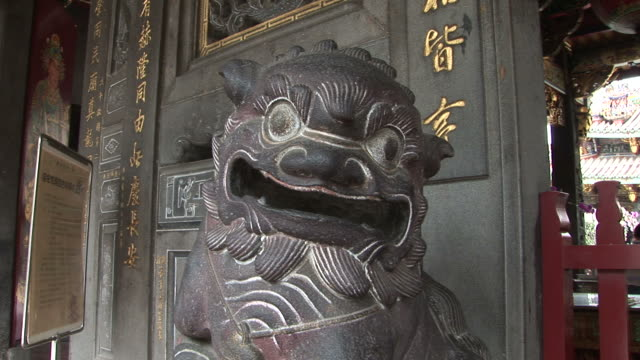 lion statue in bao-an temple taipei taiwan - imperial lion stock videos and b-roll footage