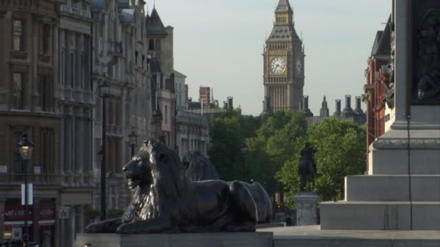 ws lion statues in trafalgar square with big ben in background / london, england - 2004 stock videos & royalty-free footage