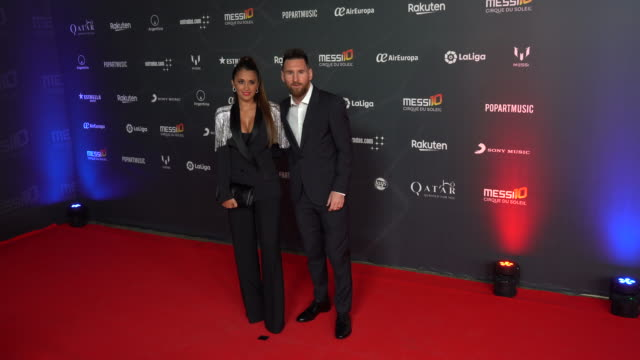 lionel messi and antonella roccuzzo pose on the red carpet for the premiere of messi10 by cirque du soleil on october 10 2019 in barcelona spain - lionel messi stock videos and b-roll footage