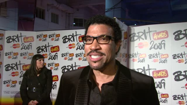 lionel ritchie on how mad and exciting the brits are and how he's going to have a good time as he's not performing tonight at the brit awards... - lionel richie stock videos & royalty-free footage