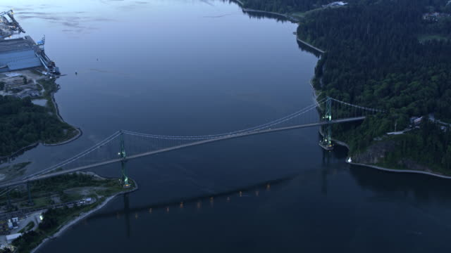 AERIAL Lions Gate Bridge in Vancouver, Canada at sundown