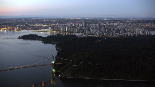 aerial lions gate bridge with vancouver at dusk - vancouver canada stock videos & royalty-free footage