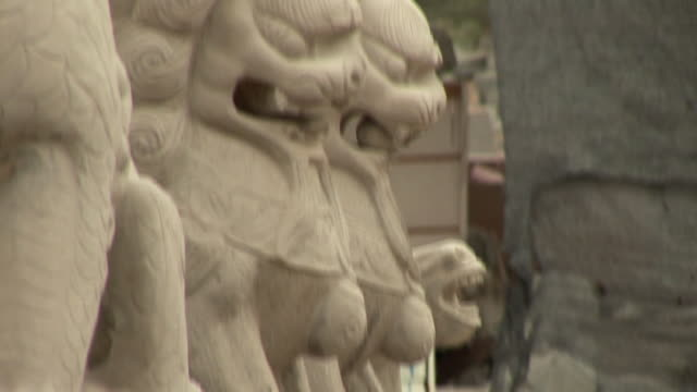 cu, tu, lions sculptures, jinan, shandong, china - imperial lion stock videos and b-roll footage
