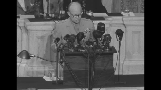 [lip flap throughout] ms dwight eisenhower supreme commander of allied expeditionary forces standing on speaker's rostrum in house chamber speaking... - allied forces stock videos and b-roll footage