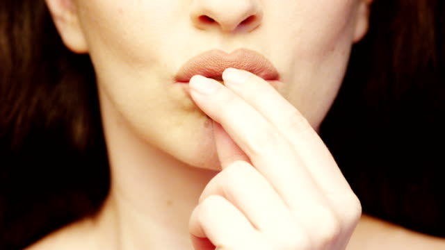 vidéos et rushes de lips eating chocolate bar a close up of woman indulging in the taste of food - bouche humaine