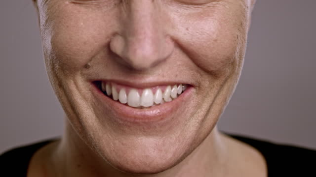 lips of a caucasian woman smiling - mole skin stock videos and b-roll footage