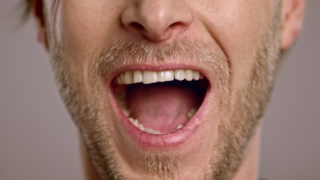 lips of a laughing caucasian man with beard - mouth open stock videos and b-roll footage