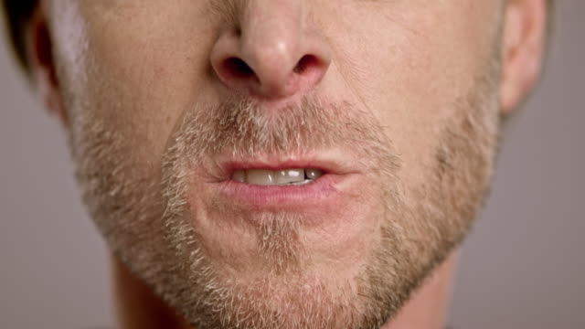 lips of a raging caucasian man with beard - lips stock videos & royalty-free footage