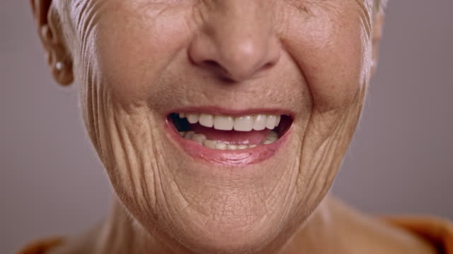 lips of a senior caucasian woman talking - human mouth stock videos & royalty-free footage