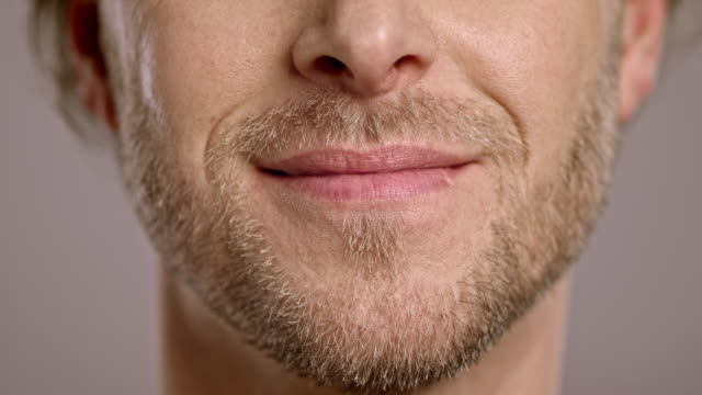 lips of a smiling caucasian man - lips stock videos & royalty-free footage