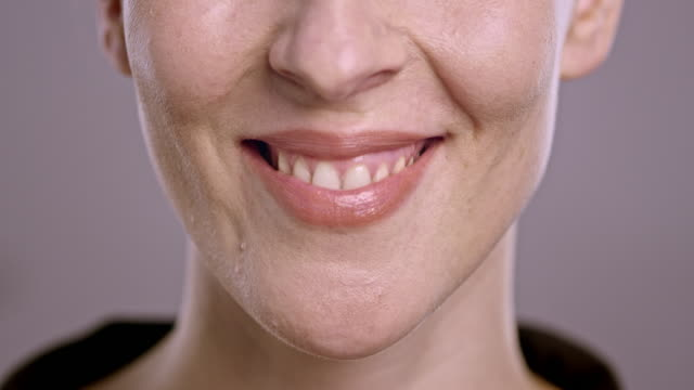 Lips of a smiling young Caucasian woman