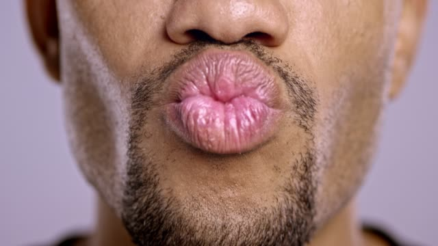 lips of a young african-american male changing moods - chewing stock videos & royalty-free footage
