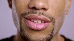 Lips of a young African-American male talking