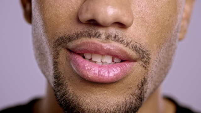 lips of a young african-american male talking - talking stock videos & royalty-free footage