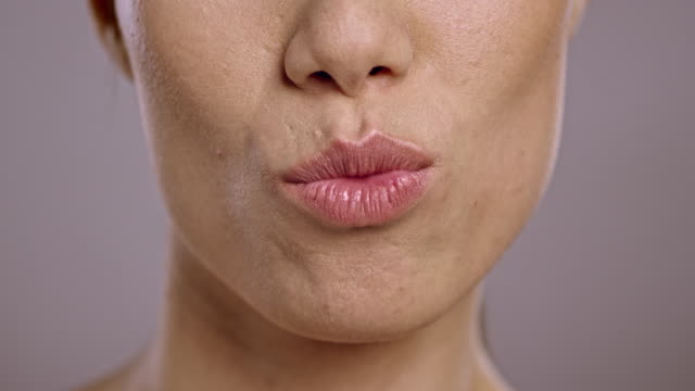 Lips of a young Asian woman sending a kiss