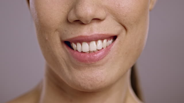 Lips of a young Asian woman smiling