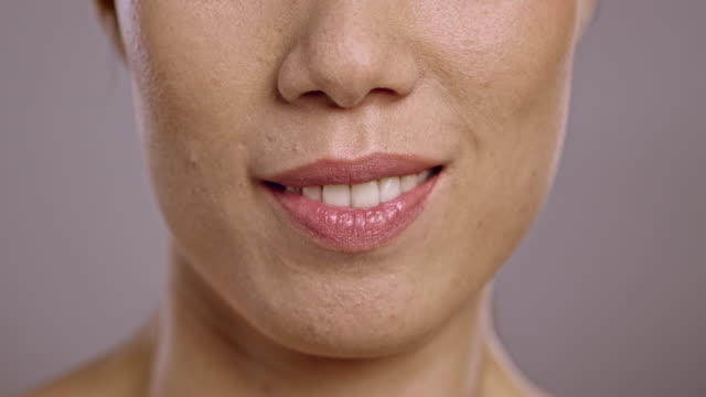 lips of a young asian woman talking - close up stock videos & royalty-free footage