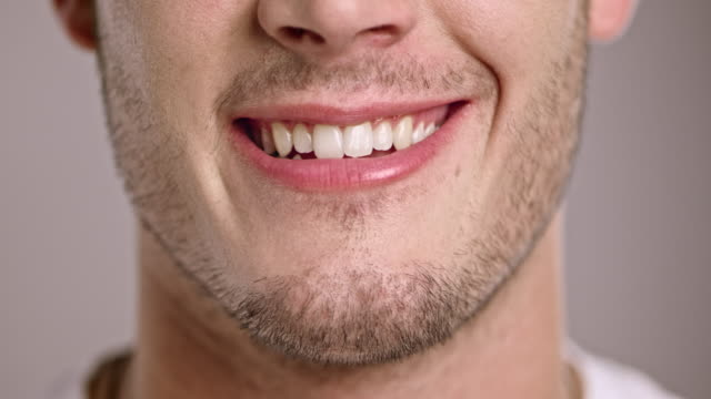 lips of a young caucasian man smiling - toothy smile stock videos & royalty-free footage