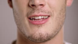 Lips of a young Caucasian man talking