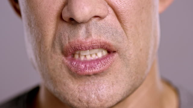 lips of an angry asian man screaming - screaming stock videos & royalty-free footage