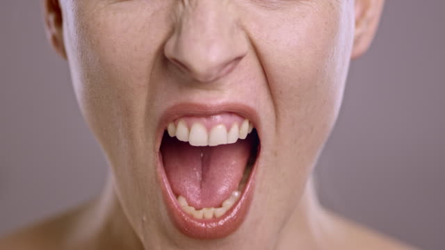 lips of an angry caucasian woman screaming in anger - mouth open stock videos and b-roll footage