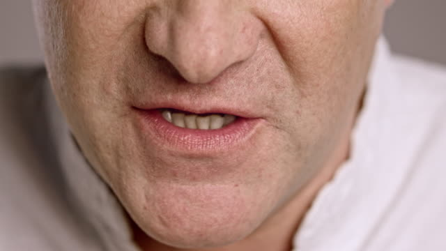 Lips of an angry middle-aged Caucasian man