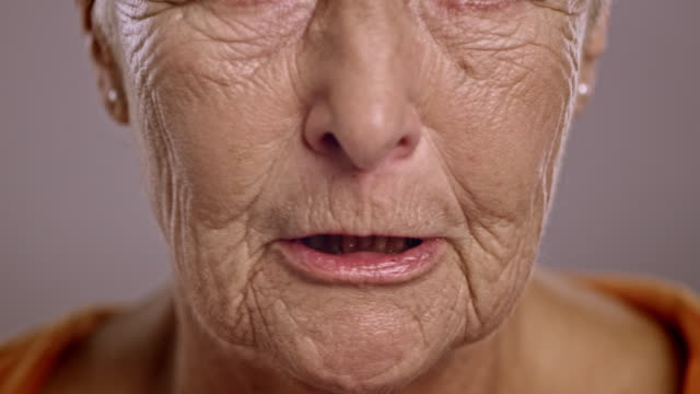 lips of an angry senior caucasian woman - senior women stock videos & royalty-free footage