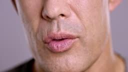Lips of an Asian man talking