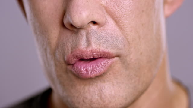 lips of an asian man talking - human mouth stock videos & royalty-free footage