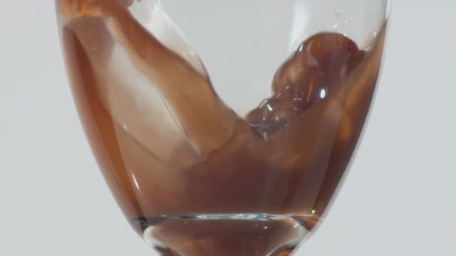 cu slo mo liquid being poured into glass / orem, utah, usa - orem stock-videos und b-roll-filmmaterial