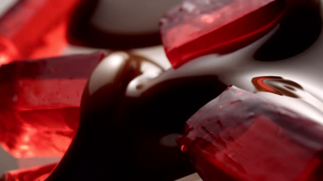 liquid chocolate covering jelly - gelatin stock videos and b-roll footage