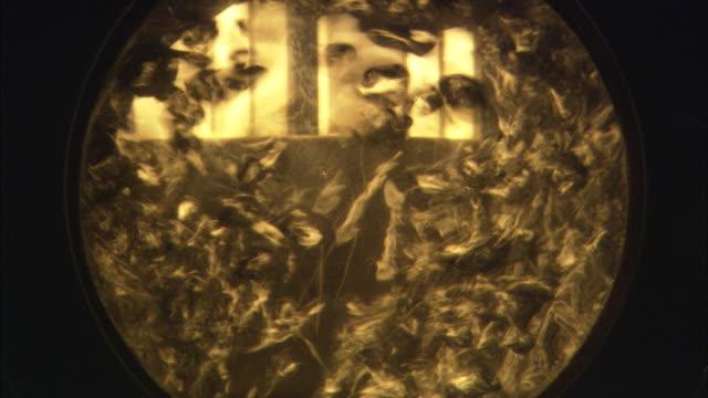 vídeos de stock, filmes e b-roll de liquid churns inside a generator. - represa hoover