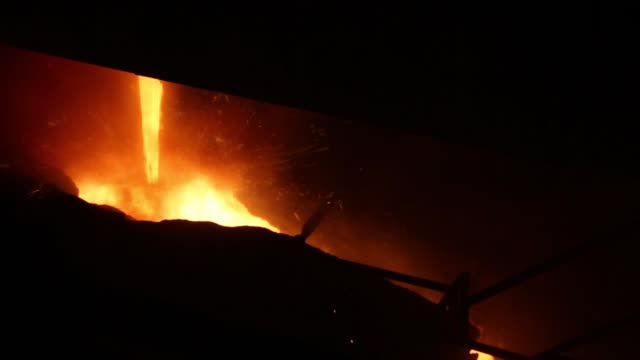 Liquid metal flows from the blast furnace at the ArcelorMittal steel plant in Zenica Bosnia on Wednesday March 16 2016