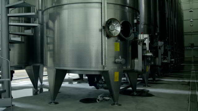 liquid storage with aluminum barrels - fermenting stock videos and b-roll footage