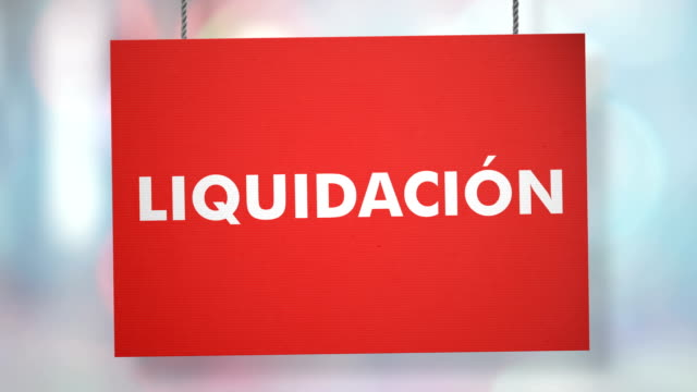 Liquidación sign hanging from ropes. Luma matte included so you can put your own background.