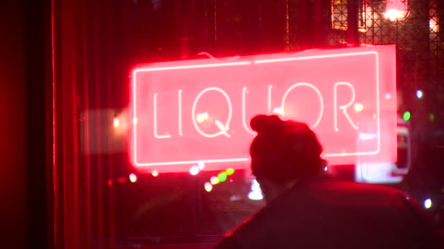 liquor sign outside pub or off license in northern ireland - neon stock videos & royalty-free footage