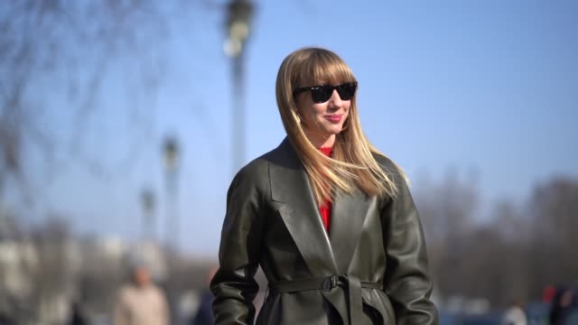 lisa aiken wears sunglasses a green leather trench coat a red dress a red bag red boots during paris fashion week womenswear fall/winter 2018/2019 on... - trench stock videos & royalty-free footage