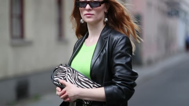 lisa banholzer is seen wearing green plaid pants vintage green shirt joop belt lacoste sandals acne dior sunglasses black blazer strenesse zebra bag... - zebra print stock videos & royalty-free footage