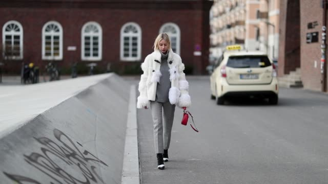 lisa hahnbueck is seen wearing white jacket grey turtleneck grey pants red louis vuitton bag heels outside marina hoermanseder during the berlin... - grey jacket stock videos and b-roll footage