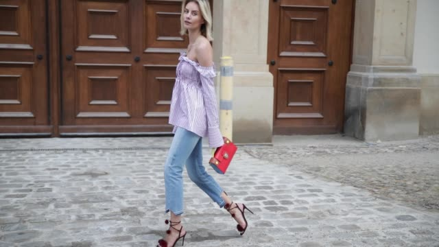 Lisa Hahnbueck wearing Victoria Beckham Striped OfftheShoulder Blouse Frame Patchwork Straight Cropped Jeans Aquazzura Wild Russian Fur Heels Dior...