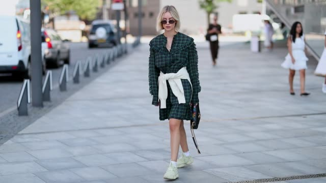 lisa hahnbueck wearing yeezy sneaker green checked dress louis vuitton bag during the copenhagen fashion week spring/summer 2019 on august 9 2018 in... - fashion collection stock videos & royalty-free footage