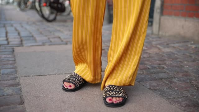 Lisa Hahnbueck wearing yellow Samsoe Samsoe suit Chanel belt bag Chanel slippers during the Copenhagen Fashion Week Spring/Summer 2019 on August 7...