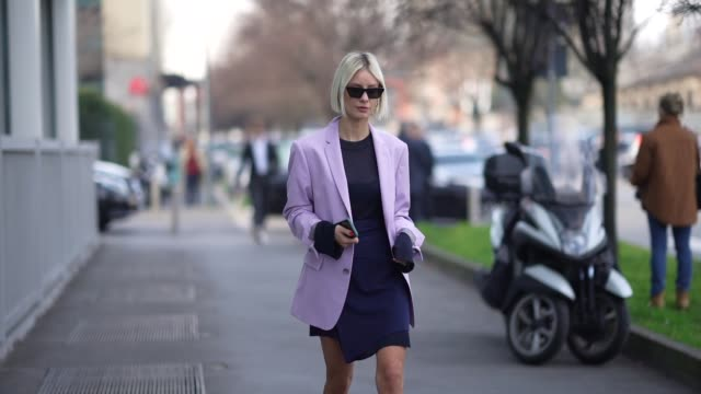 lisa hahnbueck wears sunglasses, a pale purple oversized long blazer jacket, a blue dress with a mesh part, shoes, outside boss, during milan fashion... - milan fashion week stock videos & royalty-free footage