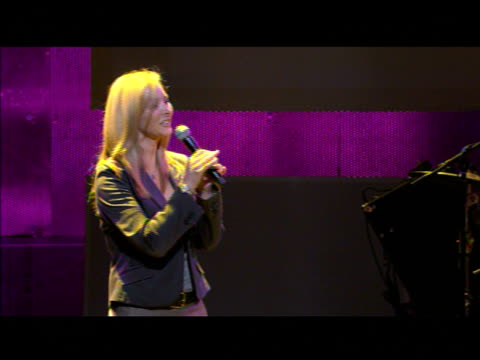 Lisa Kudrow Courteney CoxArquette joke on stage while crew sets up at the 'Rock A Little Feed A Lot' Benefit Concert at Los Angeles CA