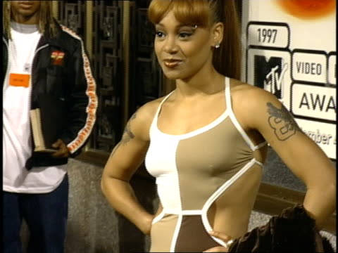 lisa 'left eye' lopes posing on the 1997 mtv video music awards red carpet - mtv video music awards stock videos & royalty-free footage