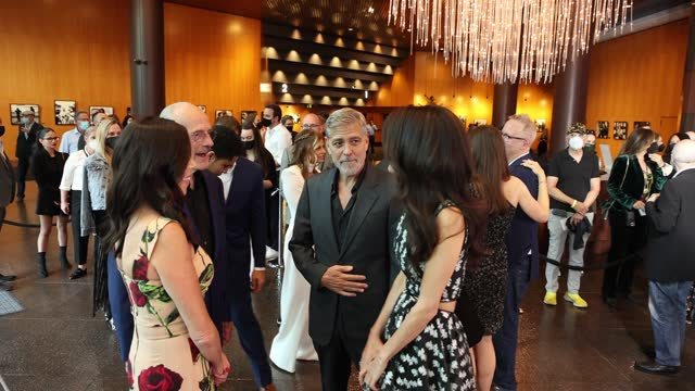 """lisa lloyd, christopher lloyd, george clooney and amal clooney attend the los angeles premiere of """"the tender bar"""" presented by amazon studios at dga... - アメリカ監督組合点の映像素材/bロール"""