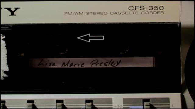 lisa marie presley cassette tape inside stereo - lisa marie presley stock videos & royalty-free footage